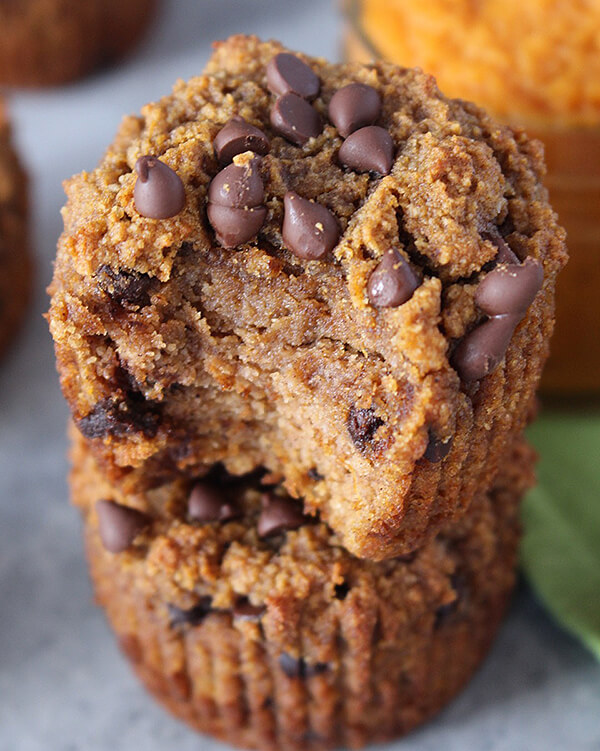 two stacked pumpkin muffins with chocolate chips
