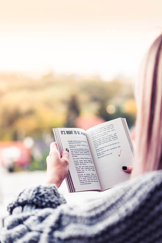 Woman outside reading a book